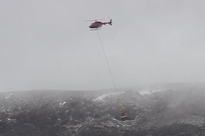 Surface Detector being flown in by Helicopter