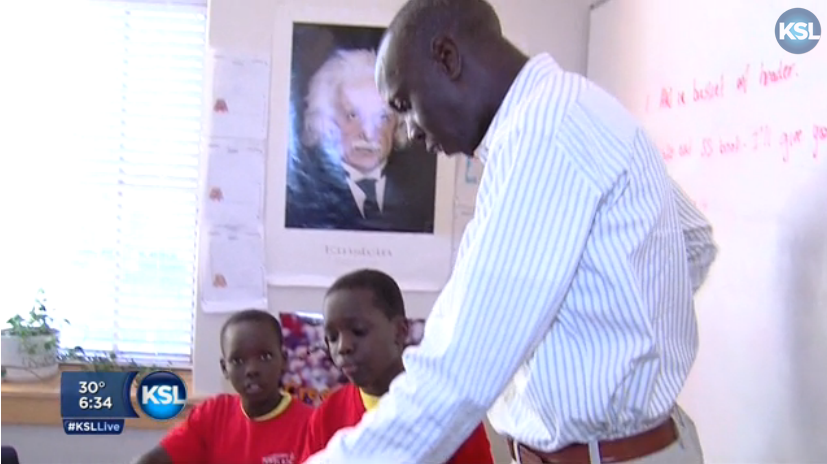 Dr. Tino Nyawelo teaches young Sudanese refugees after school.